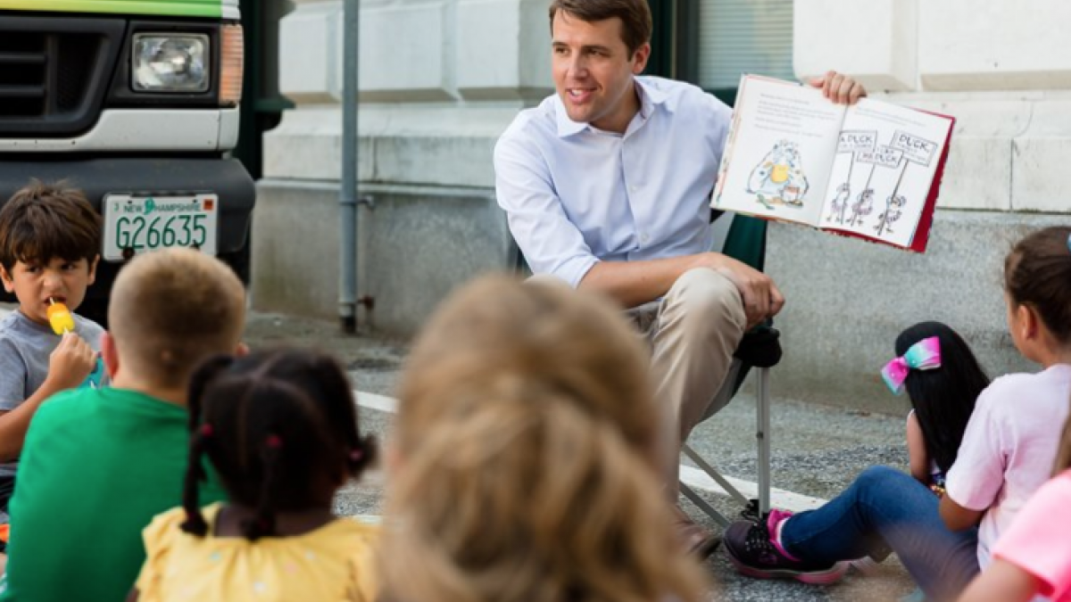 Chris reads to children at the Manchester Public Library